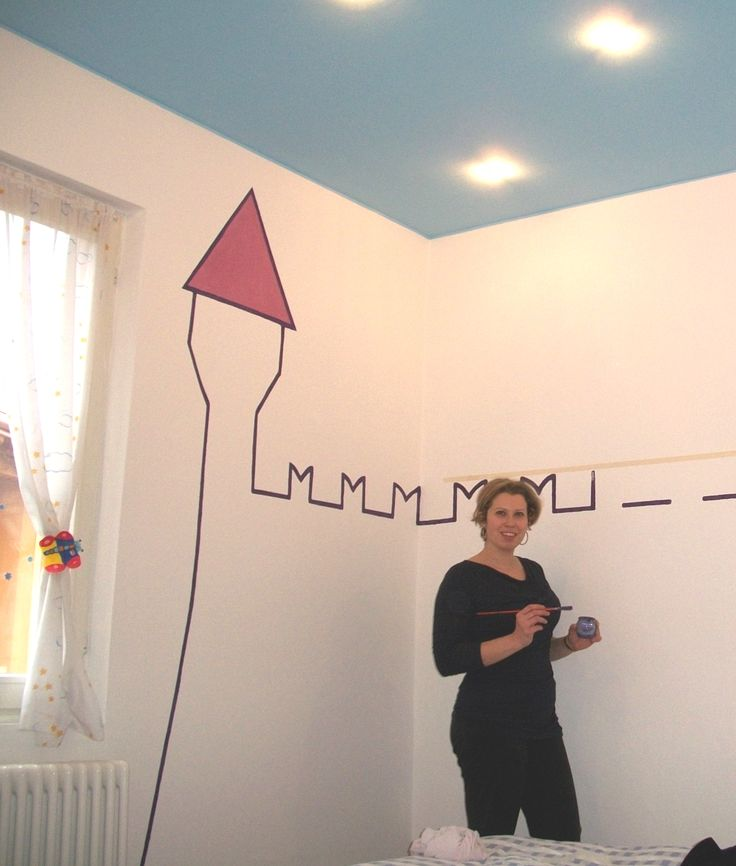 Here I was painting a castle on the wall of my kids room. If you click on the picture you can see the result (kidsroom is at the end of the post).