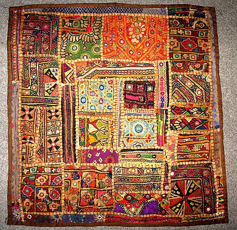Ralli Quilts- tried to find out more about this quilt. If it truly is a pieced quilt, it's AMAZING! I love the colors and design.