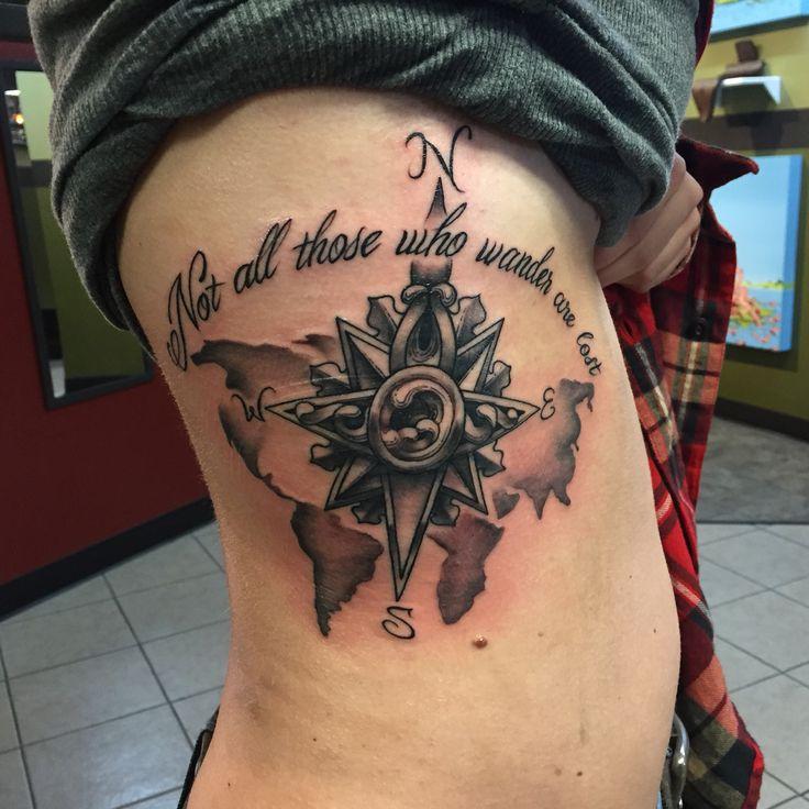 nautical world map and compass rib tattoo
