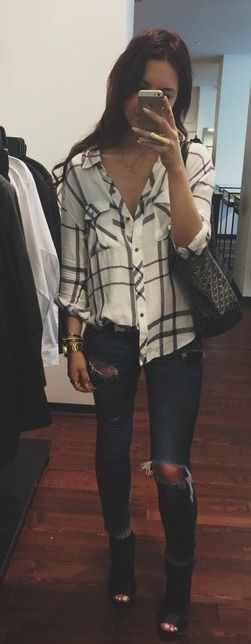 white and black plaid shirt, ripped jeans, and black heels