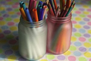 Fun Frosted Mason Jars are cute additions to a craft room or play room. They look good and help keep things tidy.