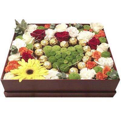 1 гербера, 5 кустовых хризантем, 9 роз, 4 гвоздики, 5 кустовых роз, 2 эустом, 16 конфет Ферреро Роше