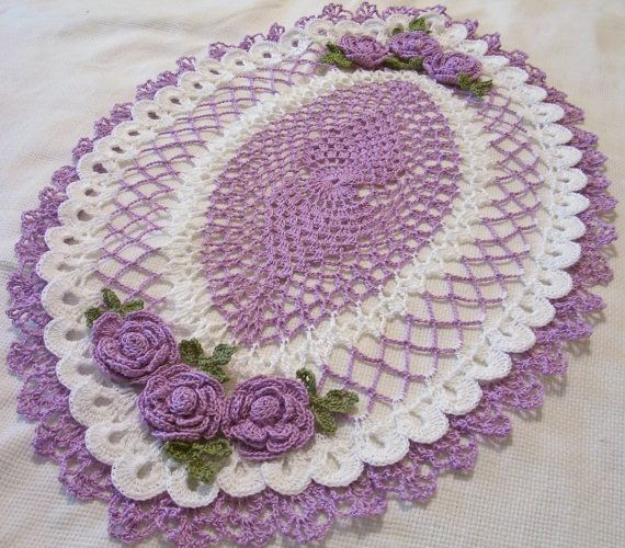 crocheted oval doily wood violet and white