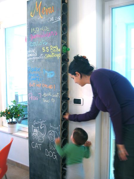 HOW TO MAKE a chalkboard wine rack with off-the-shelf drainage pipes enclosed in a fiberboard case, coated with chalkboard paint