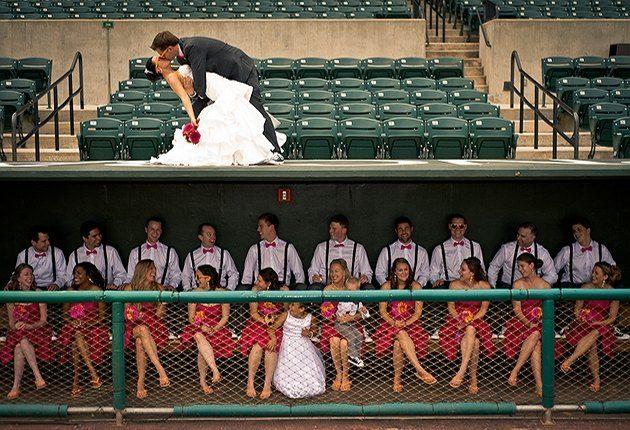 baseball diamond theme wedding bride groom pink orange ripken stadium large bridal party
