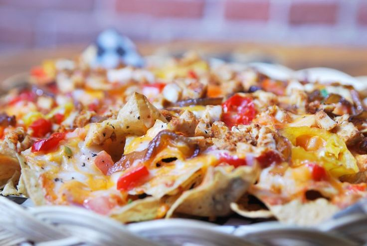 Our famous Red Stag Nachos...it's the caramelized onions and basil oil that sets them apart.  :)