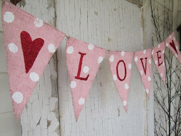 painted burlap banner with glittered letters and hearts