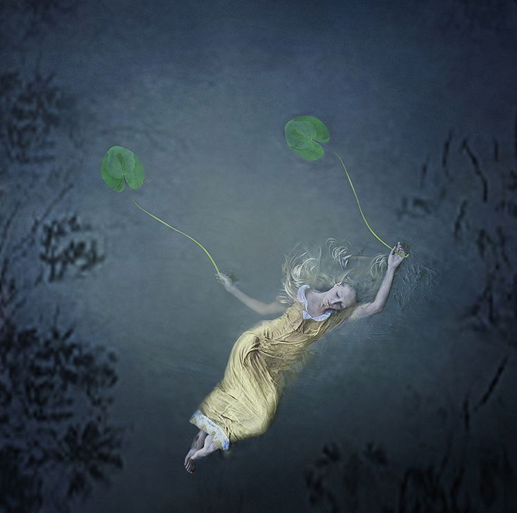 Fine art photographer Kylli Sparre (previously) has continued to create her dance-inspired photographs, almost all of which depict the artist herself in various dreamlike states and situations. Working with outdoor landscapes, and bodies of water or ice, Sparre fuses years of formal