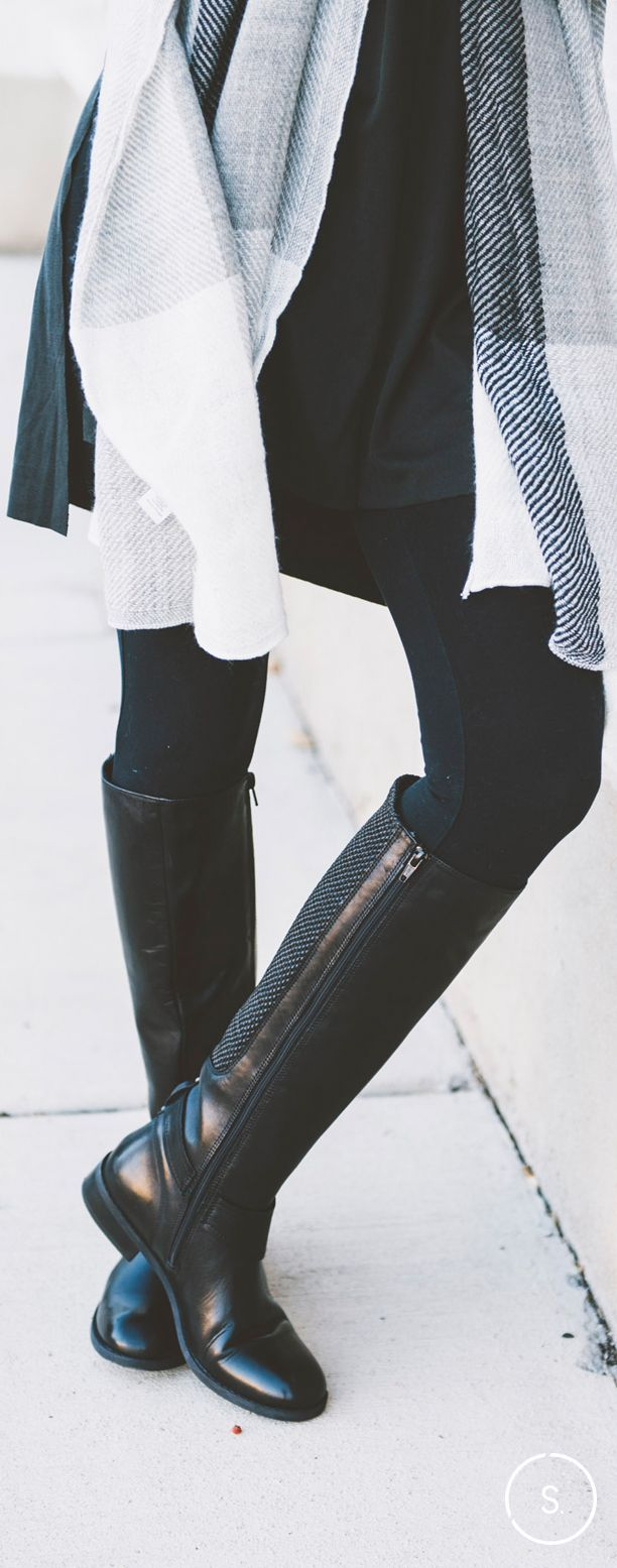 Go knee-high with your black boots for a playful look with leggings and a