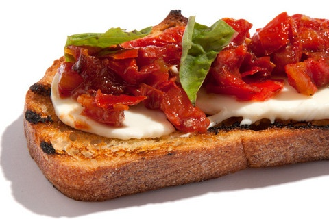Roasted Tomato and Fresh Mozzarella Bruschetta, a delicious twist on this traditional bread topper. Recipe available at http://www.chow.com/recipes/29960-roasted-tomato-and-fresh-mozzarella-bruschetta