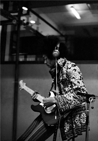 """Jimi Hendrix at Olympic Studios, London, 1967  © EDDIE KRAMER  """"This is a rare photograph of Jimi taken during the recording of his first album, Are You Experienced? Jimi had laser-like concentration in the studio, evidenced by the intense expression on his face."""" –EK"""