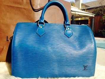 Louis Vuitton Speedy 30 Epi Handle Blue Tote Bag. Get one of the hottest styles of the season! The Louis Vuitton Speedy 30 Epi Handle Blue Tote Bag is a top 10 member favorite on Tradesy. Save on yours before they're sold out!
