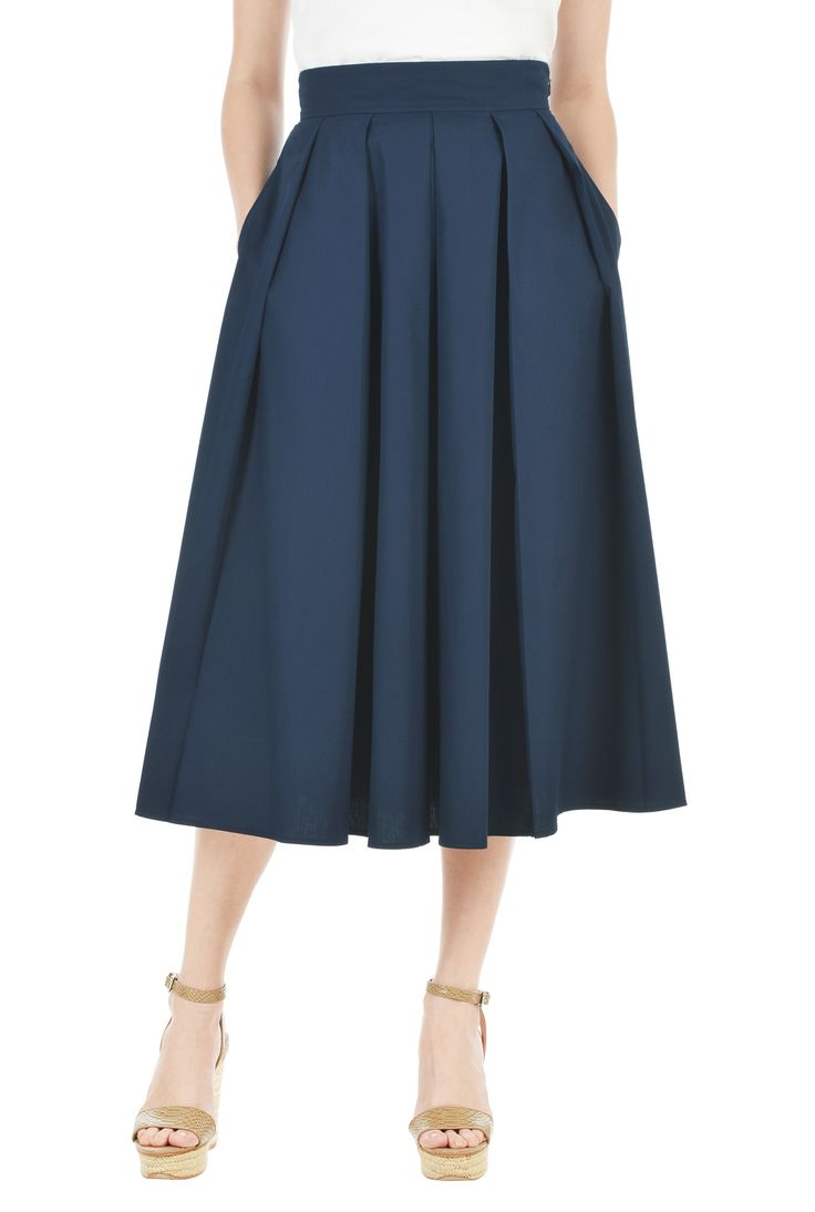 Precise pleating gives kicky style to our crisp cotton poplin skirt topped with a banded waist.