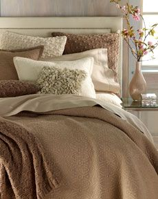 Cozy Looking Bed: My bed makes me happy. The color is good feng shui for a bedroom as well, in an earth tone.