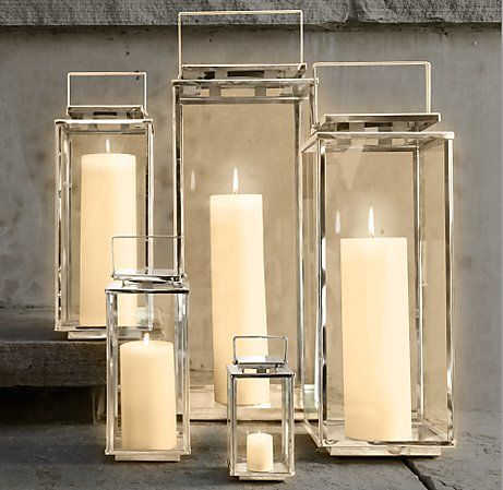 """Lately I am smitten with polished nickel lanterns.  These are my favorite:  the """"Amalfi Square Lanterns"""" by Restoration Hardware are very sophisticated."""
