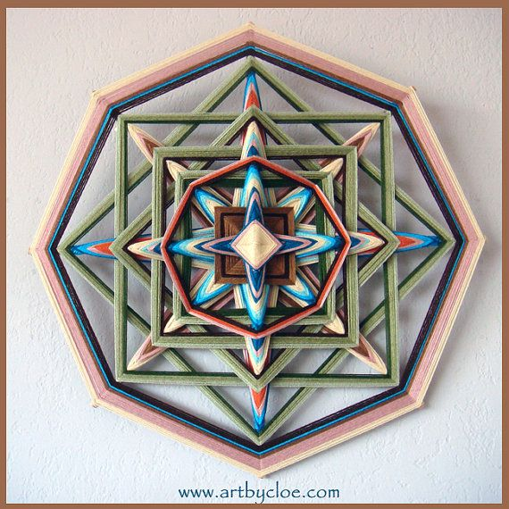 ojo de dios a mandala woven from yarn. Decorative art by artbycloe, €130.00