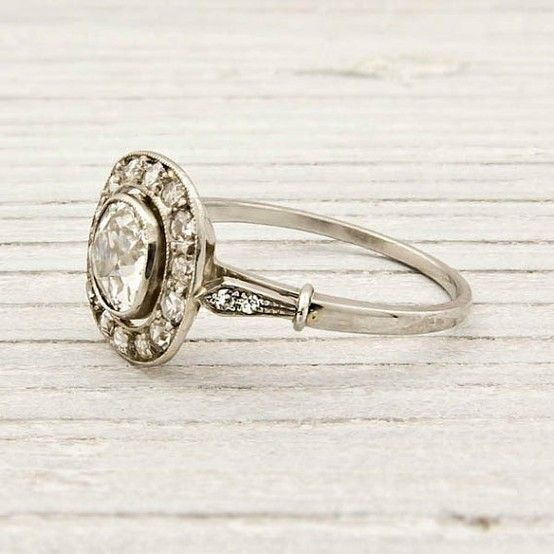 antique ring - looks like my mom's 1920s ring that my sisters and I are constantly fighting over... :)