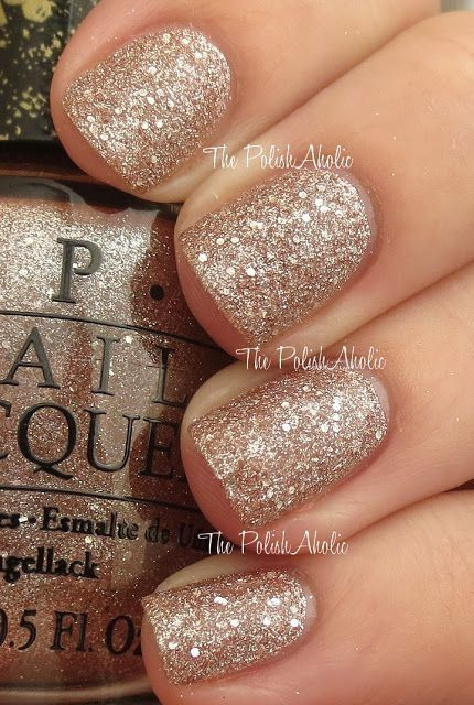 OPI- My Favorite Ornament - a champagne coloured glitter, might be more subtle than silver (& would match the shoes better). Maybe not full glitter like this though, either on the tips or a very thin coat over a French polish, or a neutral colour.