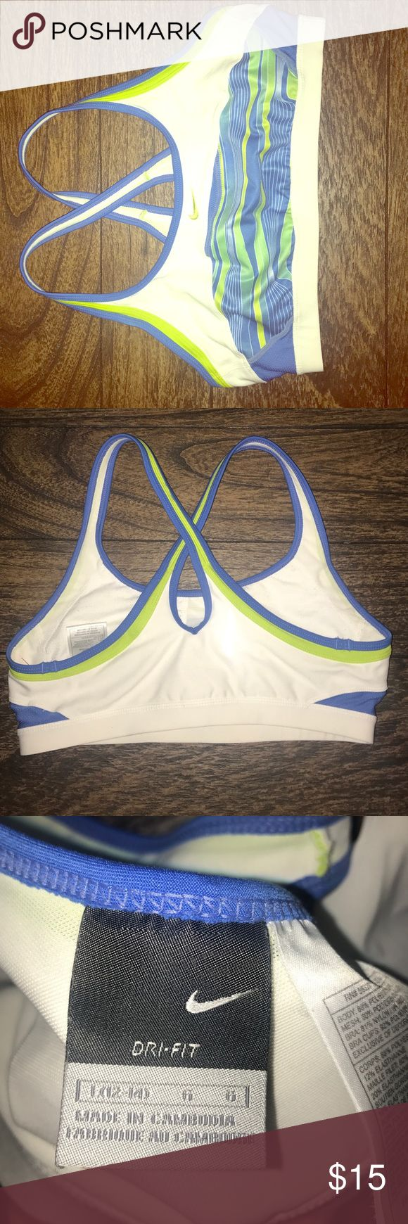 Nike dry fit sports bra Large white blue and green Nike Dry fit sports bra white blue and green size Large perfect condition crisscross strap beautiful bra worn once washed once Nike Intimates & Sleepwear Bras