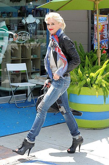 Gwen Stefani style: jeans, leather jacket, scarf, and stilettos.