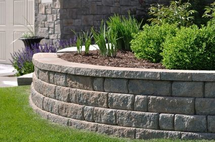 retaining wall idea for flower bed