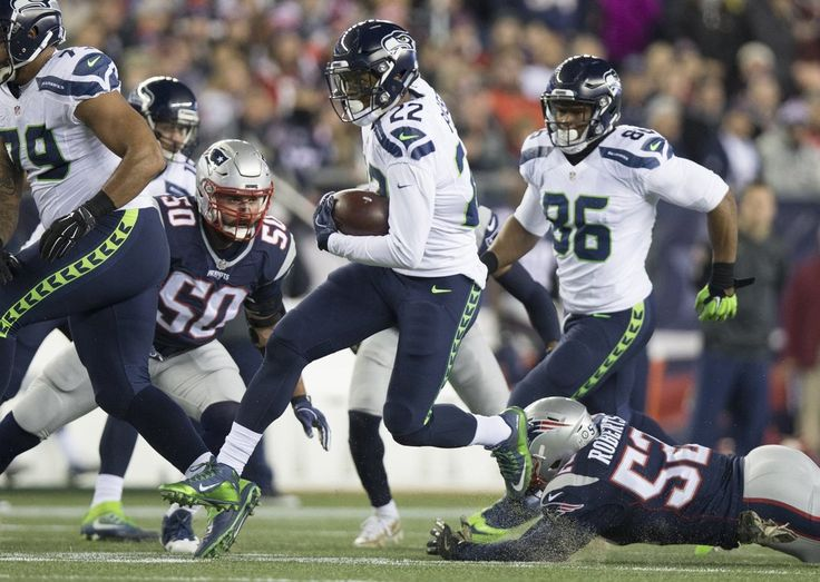 Seahawks vs. Patriots:  31-24, Seahawks  -  November 10, 2016  -   Seattle Seahawks running back C.J. Prosise (22) rushes with the ball ahead of New England Patriots Elandon Roberts during the second quarter. (Dean Rutz / The Seattle Times)