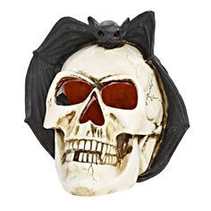 Add the ultimate scare to your home decor with this LED XLarge Skull with Bat