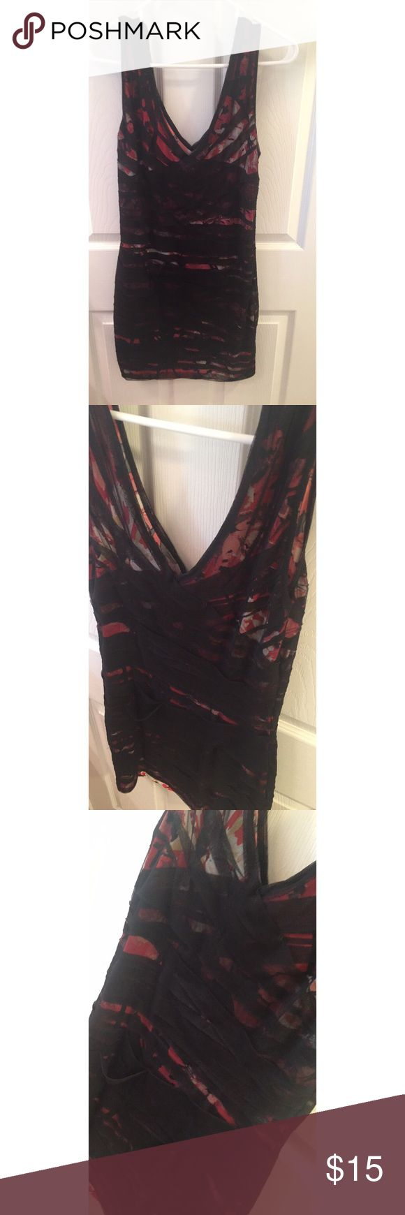 Black mesh red floral bodycon dress Pair with a pair of combat boots and a black leather jacket and you'll nail the 90's grunge look. Or wear on its own with black stilettos! This dress is so unique and fits great. Worn only once. No signs of wear and looks brand new. Forever 21 Dresses Mini