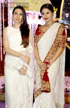 Karisma Kapoor & Urmila Matondkar in Manish Malhotra All whites were a big trend in 2014 that we see carrying through to 2015. It's a perfect for a spring / summer wedding! We also like Urmila in this white white saree with a heavy blouse. Indian wedding - Bollywood wedding - Indian designer - Indian couture #thecrimsonbride
