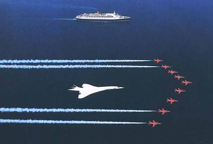The Red Arrows flying in formation with Concorde G-BOAG along with Cunard's QE2.