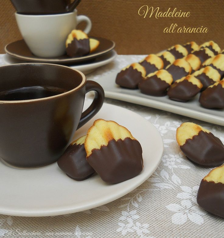 Madeleine all'arancia e cioccolato