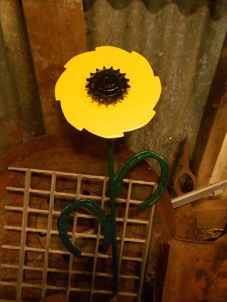 Flower from scrap metal including horseshoes.