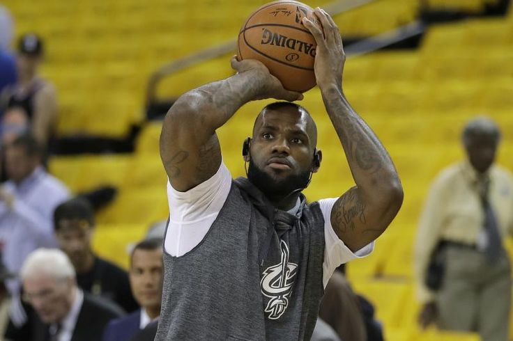 Cleveland Cavaliers forward LeBron James warms up before Game 5 of basketball's NBA Finals between the Golden State Warriors and the Cavaliers in Oakland, Calif., Monday, June 12, 2017. (AP Photo/Marcio Jose Sanchez)