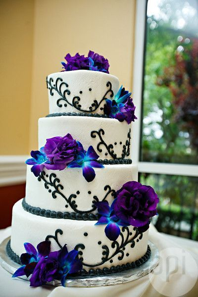 White and Purple Wedding Flowers | White Wedding Cake With Black Swirls