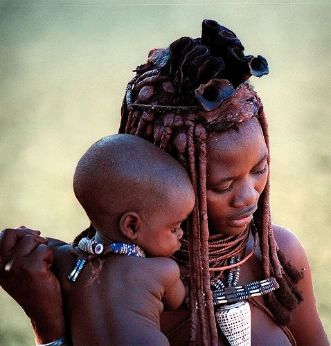 "Himba woman wearing "" leopard cone "" shell (conus leopardus ) , Namibia / Angola border