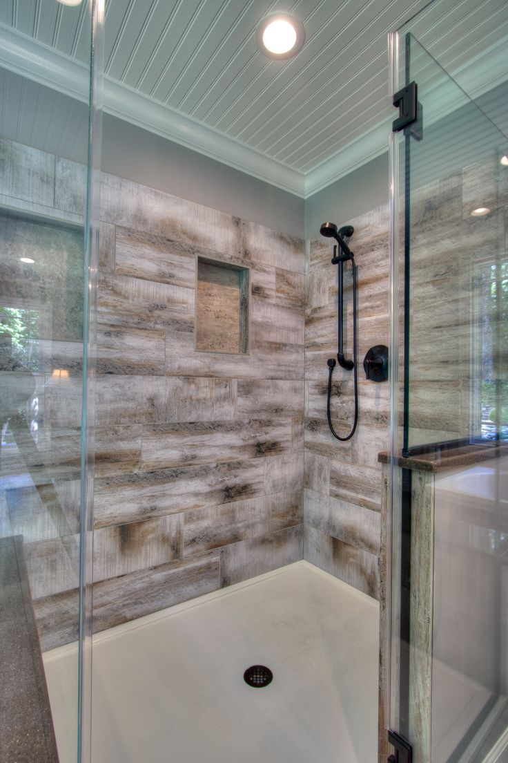 Generous walk in shower with bench seating has