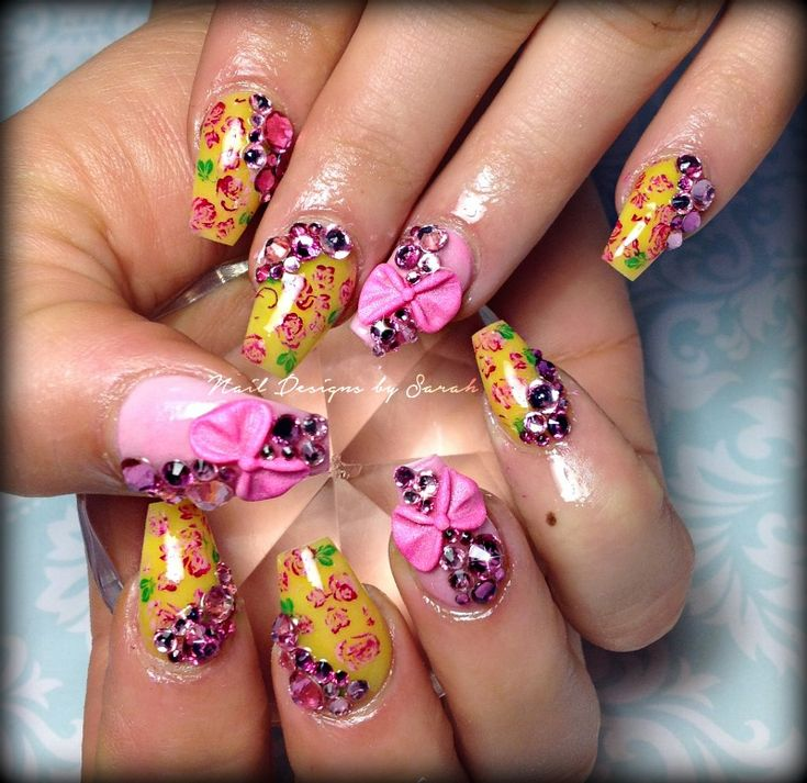 Floral coffin nails with 3D bows and lots of bling