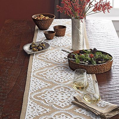 Scroll table top collection with lacy embroidered medallions.   The Company Store