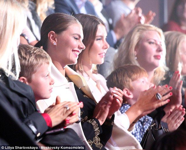 Alina Kabaeva commented on the show to one of the boys from time to time. 'And later during the break she photographed the boy with Yevgeny Plyuschenko (world champion figure skater) and Alexei Nemov (world champion gymnast)
