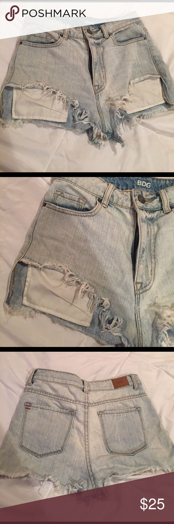 Urban Outfitter jean shorts Never worn jean shorts. High rise, high- low shorties. Shorter I'm the front with pockets coming down. Light wash. Urban Outfitters Shorts Jean Shorts