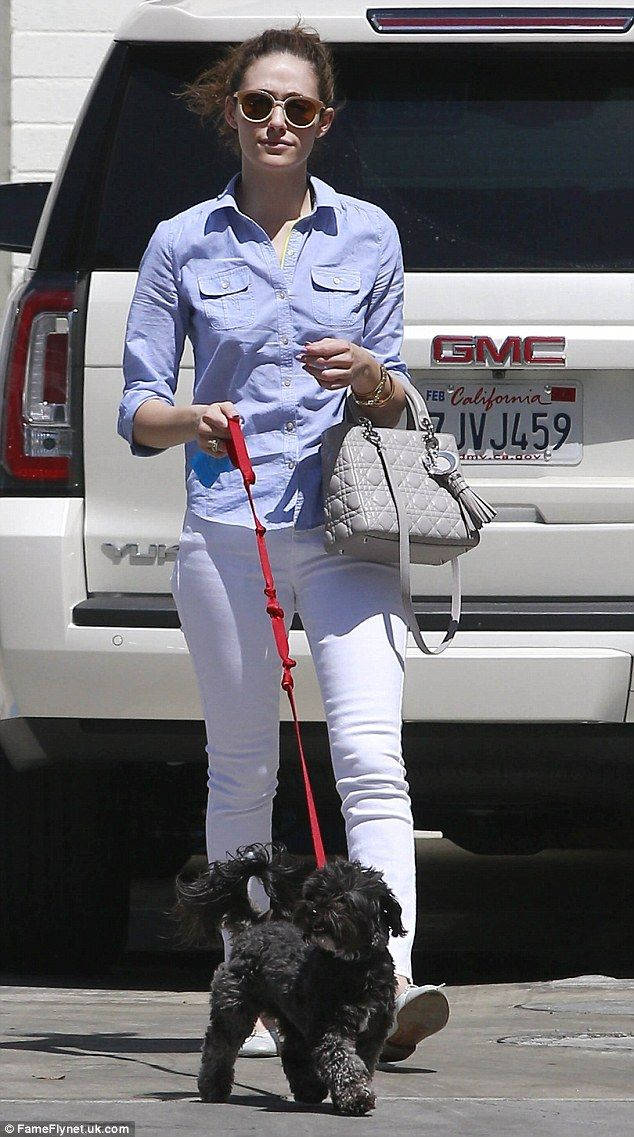 Cool customer: Rossum was dressed to perfection with white skinny jeans and a denim blouse...