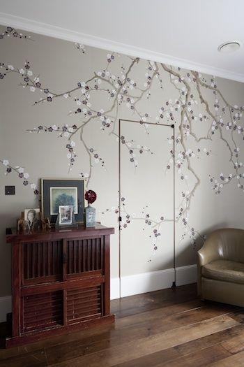 Master dressing room in walnut with églomise mirror, bronze detail and jib door.  Designed by www.artichoke-ltd.com