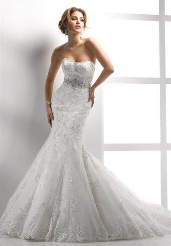 Dress Ideas    Gown features beading, lace, corset bodice and beaded belt.