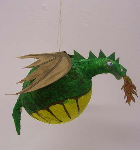 #30thbirthdayideas #hobbit I can make a sneaky pinata; red with cellophane flames, and when you beat him open, gold falls out. Yeah!!!