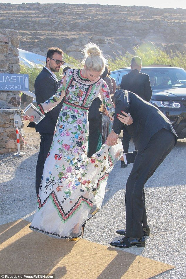 A helping hand:She was joined at the bash by her dashing boyfriend Stavros Niarchos, III,...
