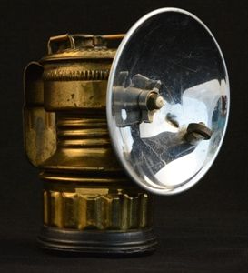 "A vintage Guys Dropper carbide caving lamp from the early 1900s.   Brass, made in USA, measures 4"" tall.   Originally used by miners, they would mix water and calcium carbide rocks to create acetylene gas which was lit to provide light in the pitch black caves and mines."