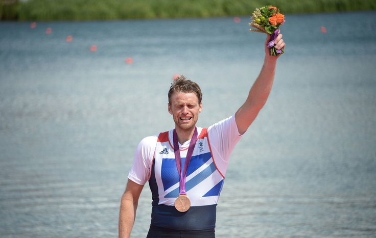 Great Britain's Alan Campbell cries on the podium with his bronze medal won for the men's single sculls final A of the rowing event at Eton Dorney Rowing Center in Eton, west of London, on August 3, 2012. (Damien Meyer/AFP/Getty Images