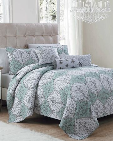 exclusively ours montrose reversible quilt collection an elegant scrolling print with a swirling stitch pattern the montrose quilt from nina campbell