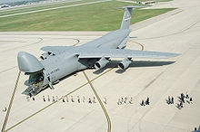 The Lockheed C-5 Galaxy is a large military transport aircraft built by Lockheed. It provides the United States Air Force (USAF) with a heavy intercontinental-range strategic airlift capability, one that can carry outsize and oversize cargos, including all air-certifiable cargo. The Galaxy has many similarities to its smaller C-141 Starlifter predecessor, and the later C-17 Globemaster. The C-5 is among the largest military aircraft in the world.