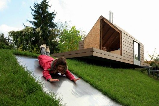 Maja's (seen sliding) house - sits atop a hill